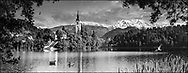 Sacred Stone - Black and white photo art print of Assumption of Mary Pilgrimage Church in the middle of Lake Bled Slovenia. by Paul Williams.