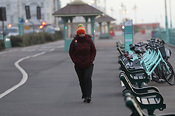 January 3, 2018 - Brighton, United Kingdom - Image licensed to i-Images Picture Agency. 03/01/2018. Brighton , United Kingdom. A lone walker wrapped up against the wind as she makes her way to work in Brighton,Sussex , as Storm Eleanor hits the UK  (Credit Image: © Stephen Lock/i-Images via ZUMA Press)
