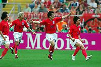 World Cup 2006 Germany Frankfurt 13/06/2006<br />Korea v Togo <br />Jung Hwan Ahn  (Korea)  celebrates second goal with Chong Gug Song and  Chun Soo Lee<br />Photo Roger Parker Fotosports International