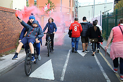 23rd August 2017 - UEFA Champions League - Play-Off (2nd Leg) - Liverpool v 1899 Hoffenheim - Liverpool fans on a bicycle let a red flare off ahead of the match - Photo: Simon Stacpoole / Offside.