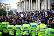 "Police lines at Occupy London protest at St Pauls, October 15th 2011. Protest spreads from the US with this demonstrations in London and other cities worldwide. The 'Occupy' movement is spreading via social media. After four weeks of focus on the Wall Street protest, the campaign against the global banking industry started in the UK this weekend, with the biggest event aiming to ""occupy"" the London Stock Exchange. The protests have been organised on social media pages that between them have picked up more than 15,000 followers. Campaigners gathered outside  at midday before marching the short distance to Paternoster Square, home of the Stock Exchange and other banks.It is one of a series of events planned around the UK as part of a global day of action, with 800-plus protests promised so far worldwide.Paternoster Square is a private development, giving police more powers to not allow protesters or activists inside."