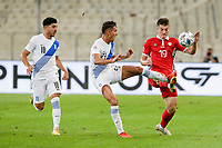 ATHENS, GREECE - OCTOBER 11: Dimitris Limniosof Greece, Dimitris Giannoulisof Greece and Ion Nicolaescuof Moldova during the UEFA Nations League group stage match between Greece and Moldova at OACA Spyros Louis on October 11, 2020 in Athens, Greece. (Photo by MB Media)