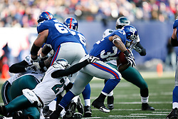 11 Jan 2009: Philadelphia Eagles safety Quintin Mikell #27 tackles New York Giants running back Derrick Ward #34 during the game against the New York Giants on January 11th, 2009.  The  Eagles won 23-11 at Giants Stadium in East Rutherford, New Jersey. (Photo by Brian Garfinkel)