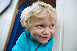 Close up portrait of young cheeky blonde boy