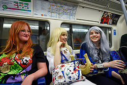 © Licensed to London News Pictures. 24/05/2019. LONDON, UK.  Cerys, Chloe and Mikayla, cosplayers from Bedfordshire, travel on the tube to attend the opening day of the bi-annual MCM Comic Con event at the Excel Centre in Docklands.  The event celebrates popular culture such as video, games, manga and anime providing many attendees with the opportunity to dress up as their favourite characters.  Photo credit: Stephen Chung/LNP