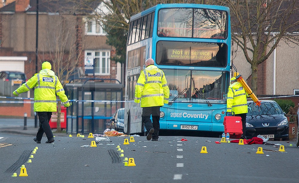 © London News Pictures. 22/02/2018. Coventry, UK.<br /> Personal belongings on the floor next to evidence markers at the scene where a toddler has died and his six-year-old brother has been left in critical condition when the pair where hit by a car which failed to stop on MacDonald Road in the Stoke area of Coventry. A 22-year-old man and a 41-year-old woman, who were diving a black Ford Focus, have been arrested. Photo credit: Dave Warren/LNP