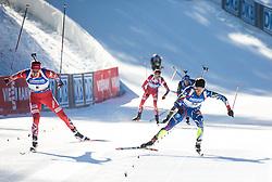 Emil Hegle Svendsen (NOR) and Jean Guillaume Beatrix (FRA) sprint at finish line  during Men 15 km Mass Start at day 4 of IBU Biathlon World Cup 2015/16 Pokljuka, on December 20, 2015 in Rudno polje, Pokljuka, Slovenia. Photo by Vid Ponikvar / Sportida