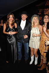 Left to right, REBECCA LOOS, WAYNE SHARPE and ANNEKA SVENSKA at the London Red Cross Ball themed 'Honky Tonk Blues' held at 99 Upper Ground, London SE1 on 21st November 2007.<br />