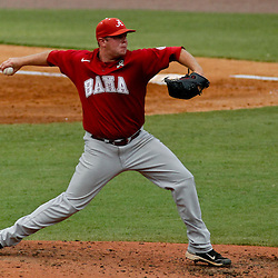 June 05, 2011; Tallahassee, FL, USA; Alabama Crimson Tide pitcher Brett Whitaker (7) throws against the Florida State Seminoles during the third inning of the Tallahassee regional of the 2011 NCAA baseball tournament at Dick Howser Stadium. Mandatory Credit: Derick E. Hingle