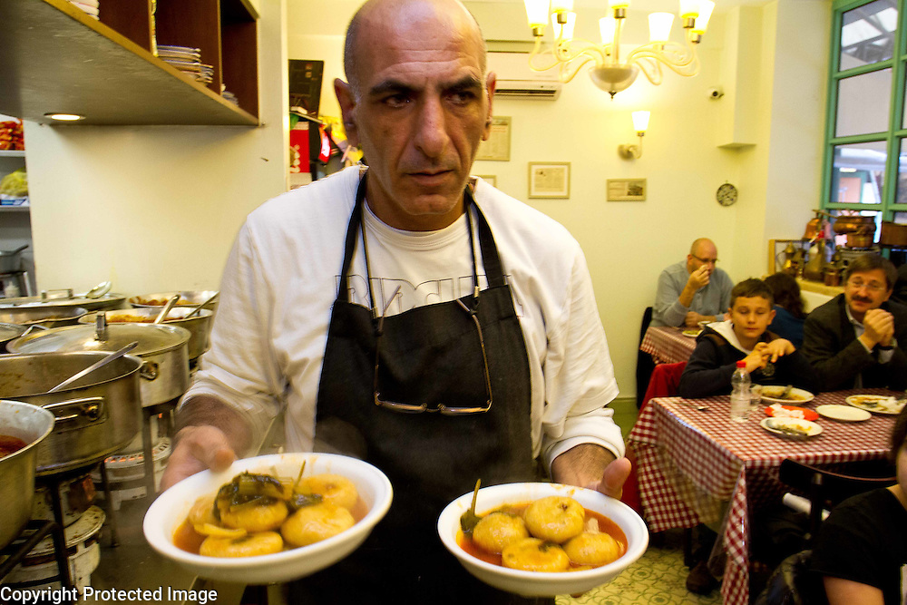 A waiter serves koubeh soup for lunch at a restaurant in Machane Yehudah, Israel. Portrait photography by Debbie Zimelman, Modiin, Israel