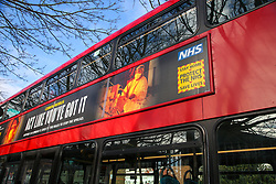 © Licensed to London News Pictures. 05/02/2021. London, UK. The government's 'Act Like You've Got It' awareness publicity campaign poster on the side of a bus in north London. The government has announced that everyone aged 50 and over will be vaccinated against coronavirus by May so that the lockdown restrictions could ease by the summer. Photo credit: Dinendra Haria/LNP