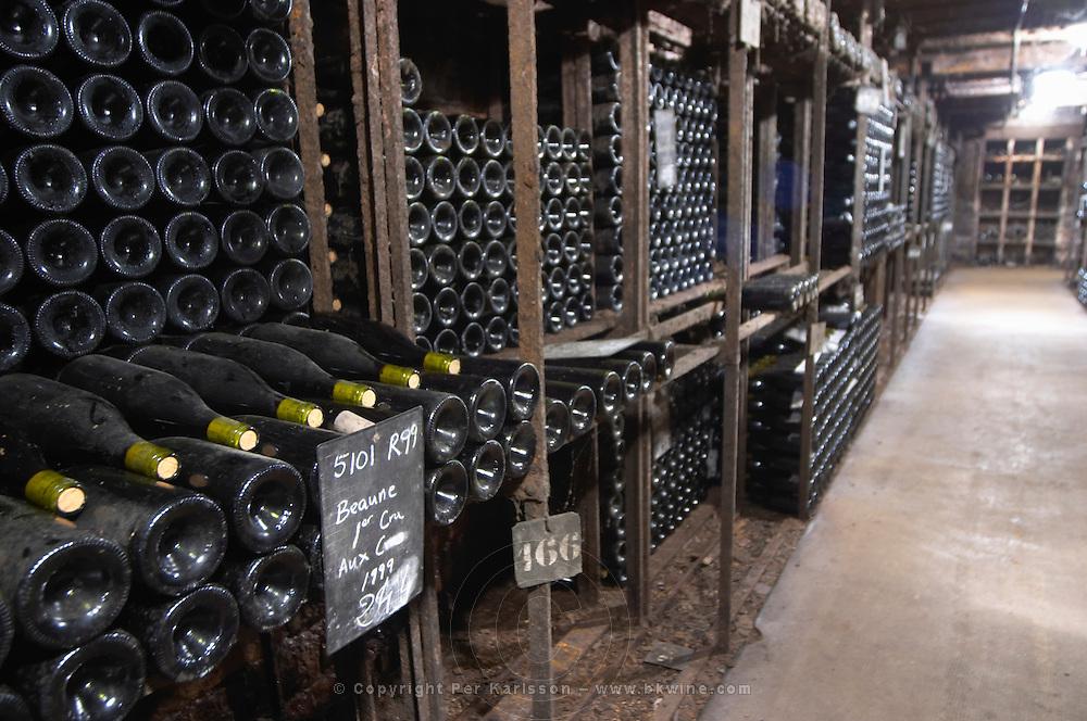 Bottles aging in the cellar. Beaune premier cru 1999. Domaine Negociant Champy Pere & Fils, Beaune, Burgundy, France