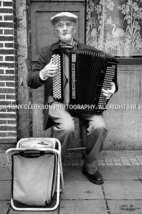 Portrait of busking street musician in Boulevard Anspach / Anspachlaan in the Belgian capital