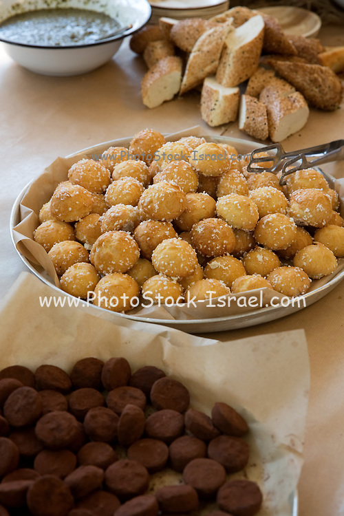 A basket with freshly baked rolls and loaves of bread