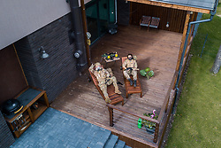 "**ALL PHOTOS WERE TAKEN WITH CONSENT AND WITH PERMISSION TO SHARE IMAGES**<br /> <br /> A photographer has used his drone to capture images of people quarantined in their homes during the coronavirus pandemic.<br /> <br /> The heartwarming photos show how Lithuanian families are spending their time in lockdown, away from the outside world.<br /> <br /> Photographer Adas Vasiliauskas explained how due the cancellation of his usual advertising photography jobs he decided to make the most of social distancing and show how people are brought together in a time of isolation.<br /> <br /> Adas explains: ""At first I thought of offering to shoot people with a telephoto lens, but then I remembered I use a drone in my wedding photography and the drone is a totally zero-human-contact way to capture things.'<br /> <br /> ""I shot a few of my friends, the photos gained a lot of likes, and the project took off.""<br /> <br /> The images show the various ways people are keeping themselves entertained during the pandemic, ranging from playing dress up with their children to sunbathing on rooftops.<br /> <br /> ""I started this project to give people a chance to brighten their day in this negative corona information environment.' Adas continues.<br /> <br /> ""I believe that these funny photos remind everyone that sitting quarantined at home can be fun too. And, of course, to remind everybody that you need to keep your social distance during these times.""<br /> <br /> Where: Vilnius, Lithuania<br /> When: 24 Mar 2020<br /> Credit: Adas Vasiliauskas/Cover Images<br /> <br /> **EDITORIAL USE ONLY. MATERIALS ONLY TO BE USED IN CONJUNCTION WITH EDITORIAL STORY. THE USE OF THESE MATERIALS FOR ADVERTISING, MARKETING OR ANY OTHER COMMERCIAL PURPOSE IS STRICTLY PROHIBITED. MATERIAL COPYRIGHT REMAINS WITH ADAS VASILIAUSKAS.**"