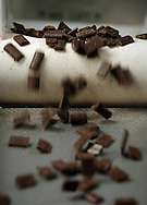 Chocolate candies fly off a conveyer belt into a bagging machine at the Guittard Chocolate factory in Burlingame, Calif. on Thursday Jan. 31, 2002. (Photo by Jakub Mosur)