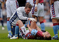 Photo: Glyn Thomas.<br />Aston Villa v West Bromwich Albion. The Barclays Premiership. 09/04/2006.<br /> Villa's Lee Hendrie lies on the floor as he receives treatment for a painful injury. He is substituted shortly afterwards.