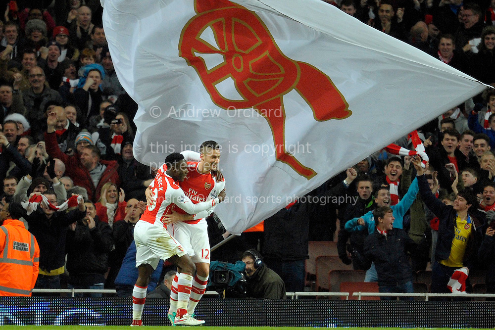 Olivier Giroud of Arsenal celebrates after scoring his teams first goal of the game with Danny Welbeck of Arsenal to make it 1-0. Barclays Premier league match, Arsenal v Newcastle Utd at the Emirates Stadium in London on Saturday 13th December 2014.<br /> pic by John Patrick Fletcher, Andrew Orchard sports photography.