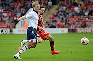 Bolton Wanderers midfielder Chris Taylor (7) and Walsall striker Andreas Makris (33) battles for possession 1-0 during the EFL Sky Bet League 1 match between Walsall and Bolton Wanderers at the Banks's Stadium, Walsall, England on 17 September 2016. Photo by Alan Franklin.