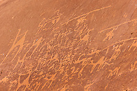 Hieroglyphic images of camels in a rock, Arabian Desert at Wadi Rum, Jordan.