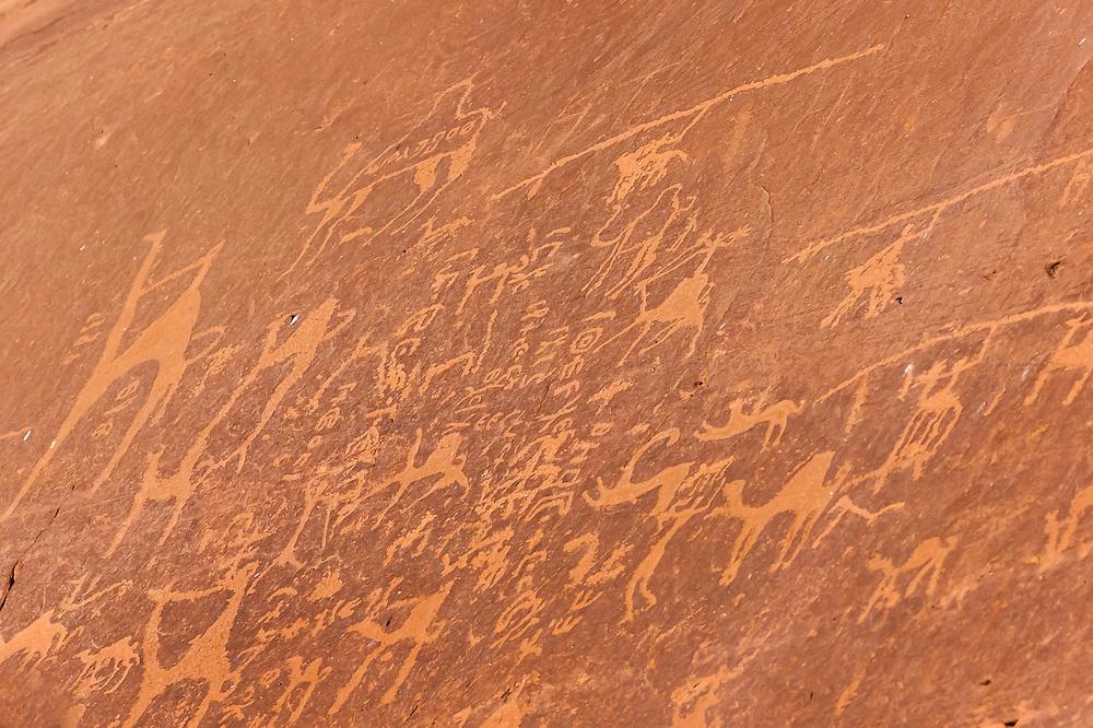 Hieroglyphic images of camels in a rock, Arabian Desert at Wadi Rum, Jordan.