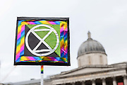 An Extinction Rebellion placard on the 7th October 2019 in Central London in the United Kingdom. Extinction Rebellion protesters occupy locations across central London including Westminster Bridge, Whitehall and Trafalgar Square in a wave of protests planned to continue for 2 weeks.