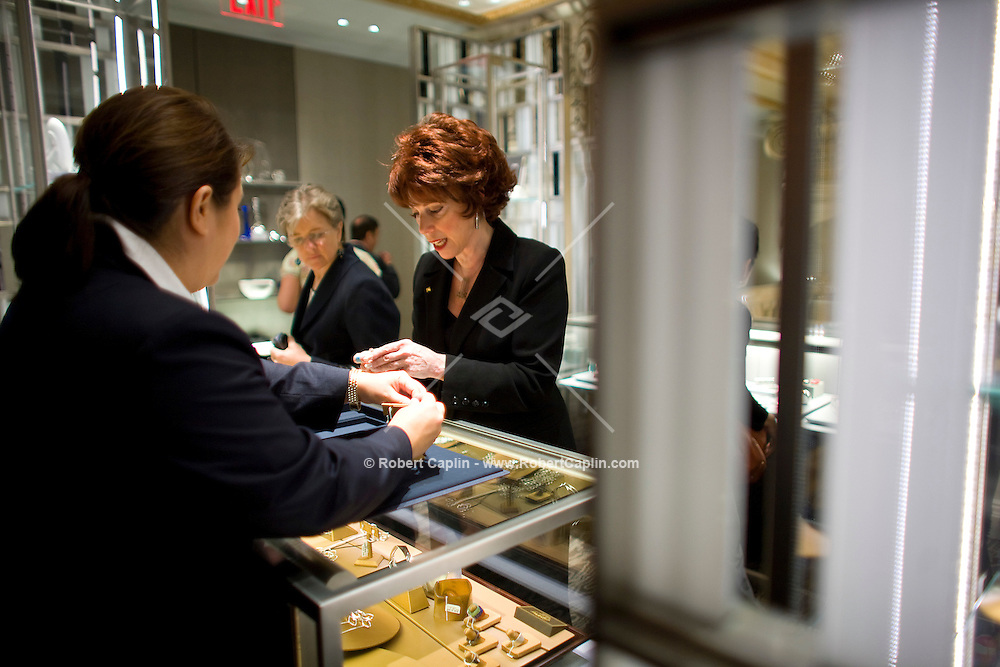 Merrie L. Davis tries on earrings inside the new Wall Street location Oct. 10, 2007 the day Tiffany & Co. went public and for the ribbon cutting of their new Wall Street store in New York.