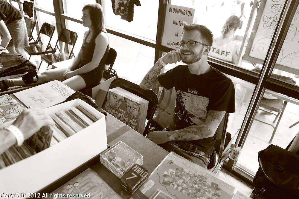 Pete Shaw of Let's Pretend Records works the merchandise table during the 2012 Plan-It-X Fest in Bloomington, Ind. The Plan-It-X Fest which was from June 22-24 was a fundraiser for several charities and drew dozens of bands and hundreds of punk rock fans from across the United States and the world. Plan-It-X Records (also known as PIX) is an independent record label in the United States. The festival first took place in 2004 to celebrate the 10-year anniversary on the label. Bands performing at the festival may or may not be on the label.