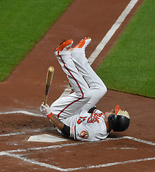 August 3, 2017 - Baltimore, MD, USA - The Baltimore Orioles' Manny Machado falls down after he strikes out in the first inning against the Detroit Tigers at Oriole Park at Camden Yards in Baltimore on Thursday, Aug. 3, 2017. (Credit Image: © Lloyd Fox/TNS via ZUMA Wire)