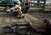Brody Cress, of Cheyenne, Wyoming, stretches before the saddle bronc riding event, Sunday, Aug.  4, 2013, at the Boulder County Fair in Longmont. The CPRA rodeo featured nine events including bareback riding, steer wrestling, tie-down roping, breakaway roping, saddle bronco riding, mixed team roping, open team roping, ladies barrel racing and bull riding.<br /> (Matthew Jonas/Times-Call)