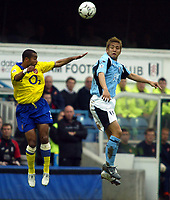 Photo. Chris Ratcliffe<br /> Fulham v Arsenal. FA Premiership. 09/05/2004<br /> Ashley Cole and Junichi  inamoto go up for an aerial ball