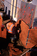 A5EXH4 Bricklayers building a new wall on a building site