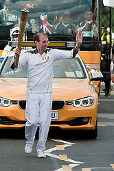 The Olympic Torch relay reaches Sheffield on day 38 coverage from the Chapeltown - Ecclesfield - Parson Cross section of the Journey.<br /> Olympic Torch Bearer 113 Patrick Nevin<br /> 25 June 2012.<br /> Image © Paul David Drabble