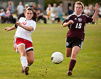 Pittsfield's Rebekah Adams drives the ball ahead of Derryfield's Margo Pierson Tuesday afternoon at Drakes Field.  (Karen Bobotas/for the Concord Monitor)
