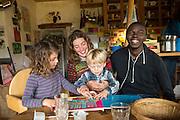 November 9, 2016 - Breil-sur-Roya, France: Camille, 33, with her children Ayla, 5, and Telian, 3, has been housing Aboubakar (R), a migrant from Guinee-Conakry, for three months. 120 inhabitants of the village Breil-sur-Roya in the Roya valley, in the Alps on the French Italian border, formed a  network to help migrants who walked into the valley from Ventimiglia, Italy.<br /> <br /> 9 novembre 2016 - Breil-sur-Roya, France: Camille, 33 ans, avec ses enfants Ayla, 5 ans, et Telian, 3 ans, héberge depuis trois mois Aboubakar (R), un migrant de Guinée-Conakry. 120 habitants du village de Breil-sur-Roya, dans la vallée de la Roya, dans les Alpes, à la frontière entre la France et l'Italie, ont formé un réseau pour venir en aide aux migrants entrés dans la vallée de Ventimiglia en Italie.