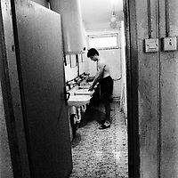 Common bathrooms. Living in a camp means that you are leaving behind all your privacy. Everything is shared with everybody....During the summer1999, over 245,000 Serbs and Roms fled to Serbia and Montenegro from or within Kosovo in fear of reprisals from the majority Albanian population, after NATO air strikes had forced the withdrawal of Yugoslav. In 2003, less than 2% of them had returned and a large number of these internally displaced persons (IDPs) were still living in camps in very difficult conditions..In addition, around 5,000 IDPs, mainly of Roma ethnicity, are living in unrecognized collective centres, makeshift huts, corrugated metal containers and other substandard shelters. .This work  was meant to look at how the life of children and young adults is affected by the fact that they are IDPs. I asked myself more specifically what would be different for these children/young adults from the 'normal' people of their age as far as education, health, social life, family, 'love' life and leisure are concerned. ..Salle de bains communes. Vivre dans un camp veut dire que la vie privée n'existe plus. Tout est partagée avec tout le monde....Pendant l'été 1999, plus de 245 000 serbes et roms ont fuit le Kosovo pour chercher refuge en Serbie ou au Montenegro, par peur de représailles de la part de la majorité de la population albanaise après que les forces de l'OTAN aient forcé l'armée yougoslave à se retirer. En 2003, moins de 2% d'entre eux étaient rentrés chez eux et le plus grand nombre de ces 'déplacés' (IDPs) vivaient encore dans des centres d'accueil dans des conditions très difficiles..Environ 5 000 IDPs, la plupart romas, vivent dans des centres non reconnus faits de containers ou d'abris de fortune. .Ce travail s'est focalisé sur les jeunes IDPs, sur les conséquences de leur état de 'déplacés' sur leur vie et plus particulièrement dans les sphères concernant l'éducation, la santé la vie sociale, la vie de famille, la vie amoureuse et les loisirs..