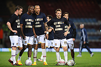Football - The Championship - West Ham United vs. Middlesbrough<br /> West ham players Carlton Cole, John Carew and Matt Taylor wearing T'shirts with 'Get well soon Muamba' on them before the kick off.