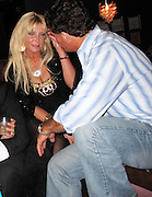 **EXCLUSIVE**.Pamela Bach-Hasselhoff and Lee Levy..Pamela Bach-Hasselhoff making out, kissing, touching each others legs all night with new guy, Lee Levy, a David Hasselhoff look-a-like. They also left together..Devon Guzzie Birthday Party Hosted by Pamela Bach-Hasselhoff and performance by Baha Men Band..Empire Nightclub..Hollywood, CA, USA..Friday, September 25, 2009..Photo By Celebrityvibe.com.To license this image please call (212) 410 5354; or Email: celebrityvibe@gmail.com ; .website: www.celebrityvibe.com.