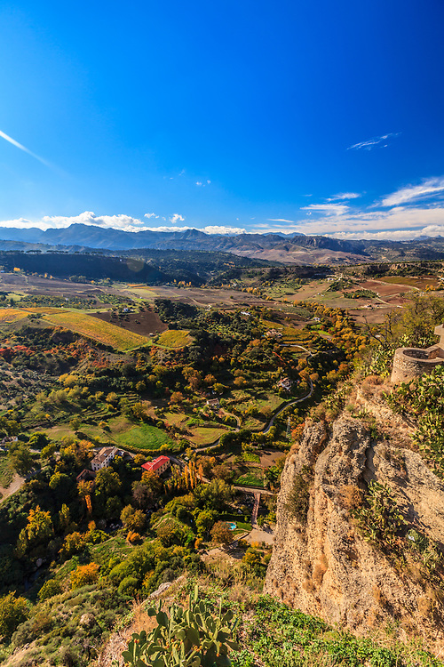 Beautiful Andalusian countryside in Ronda, Spain. The Natural Park Sierra de Grazalema is dimly seen on the horizon.