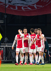 Quincy Promes #11 of Ajax and Dusan Tadic #10 of Ajax, Nicolas Tagliafico #31 of Ajax, Carel Eiting #8 of Ajax celebrate the first goal for Ajax during the match between Ajax and PSV at Johan Cruyff Arena on February 02, 2020 in Amsterdam, Netherlands
