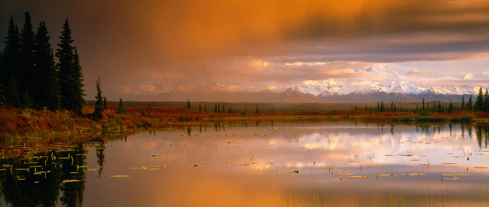 USA, Alaska, Denali NP, Incredible sunset clouds as viewed from a tundra pond looking towards Mt McKinley and the Alaska Range