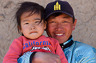 Portrait of a Mongolian Shepherd with his son, Inner Mongolia, China