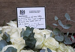 © Licensed to London News Pictures. 11/09/2021. London, UK. Flowers from British Prime Minster Boris Johnson, left at a memorial in Grosvenor Square in London on the 20th anniversary of the 9/11 terrorist attack. The attacks, which killed a total of 2,977 people, saw passenger jets seized by suicide attackers, flown into the Twin Towers of the World Trade Center in New York and the The Pentagon building. Photo credit: Ben Cawthra/LNP