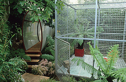 Play area 'cage' and oval wire mesh tunnel.