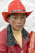 A Tibetan boy on pilgrimage to the sacred Jokhang Temple, Lhasa, Tibet.
