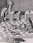 Refining gold: furnaces, 2,2, and operator, 9.  The man near 4 is gradually heating a crucible surrounded by a ring of burning coals: to increase the heat coals were be raked into a smaller circle. From 1683 English edition of Lazarus Ercker  'Beschreibung allerfurnemisten mineralischen Ertzt- und Berckwercksarten' originally published in Prague in 1574. Copperplate engraving.
