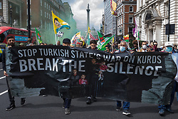 Members of the Kurdish community and supporters take part in a Defend Kurdistan demonstration on 3rd July 2021 in London, United Kingdom. Defend Kurdistan is an international initiative begun in June 2021 calling for a halt to Turkish attacks on, and the withdrawal of all Turkish troops and Islamist mercenaries from, South Kurdistan. Similar demonstrations took place in other cities around the world.
