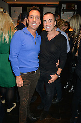 Left to right, BRUNO TONIOLI and JULIEN MACDONALD at a party to celebrate the publication of Honestly Healthy Cleanse by Natasha Corrett held at Tredwell's Restaurant, 4a Upper St.Martin's Lane, London on 14th January 2015.