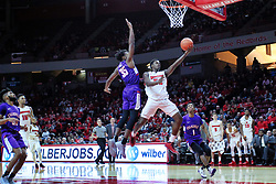 NORMAL, IL - January 05: Milik Yarbrough heads down the lane beating John Hall to the hoop during a college basketball game between the ISU Redbirds and the University of Evansville Purple Aces on January 05 2019 at Redbird Arena in Normal, IL. (Photo by Alan Look)