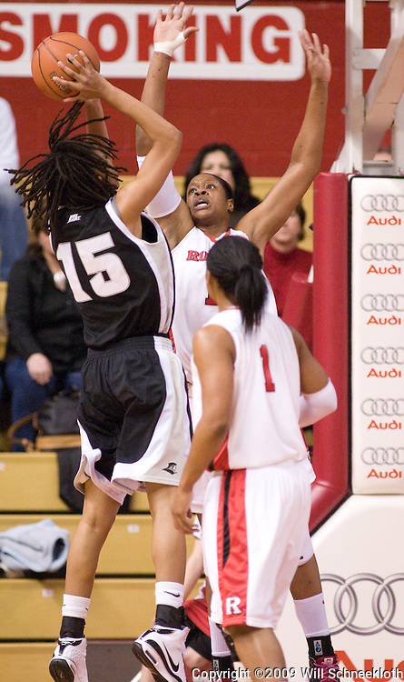 Feb 21, 2009; Piscataway, NJ, USA; Rutgers center Kia Vaughn (facing camera) goes up to block a shot by Providence forward Mi-Khida Hankins (15) during the first half of Rutgers' 55-42 victory over Providence at the Louis Brown Athletic Center.